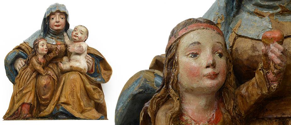 Anna Selbdritt, Süddeutsch Gotische Anna Selbtritt auf Thronbank sitzend. Maria steht auf der rechten Seite Annas und reicht dem Jesuskind eine Traube. Der Jesusknabe sitz auf dem Schoß der Hl. Anna. Die rechte Hand greift zu Ihrem Hals. Die Inkarnate gut erhalten, die Kleidungsfassung fragmentarisch. Lindenholz Rückseitig gehöhlt. Maße: H 50 x B 22 x T 22 cm Niederbayern, Landshut um 1520 - 1550