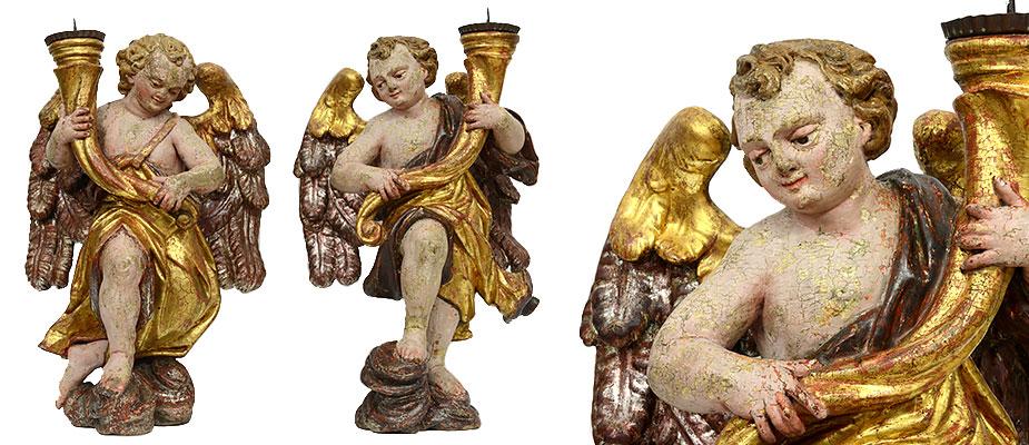 Leuchterengel, Österreich Barockengel auf Wolken stehend, einander zugewandt, in den Händen die Kerzenleuchter als Füllhörner. Die Skulpturen in Zirbenholz vollplastisch geschnitzt. Die Aussenseiten der Kleidungen vergoldet. Die Innenseiten versilbert. Die Flügel stark bewegt und kräftig geschnitzt. Die Wolken versilbert. Originale Farbfassung und Vergoldung. Maße: H 50 x B 34 x T 23 cm Österreich, Salzburger Land um 1700